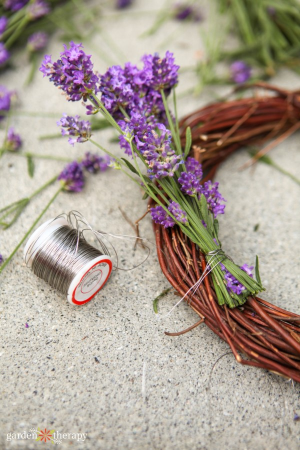 adding lavender bundles to wreath