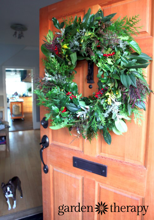A warm welcome to holiday guests with this huge evergreen wreath