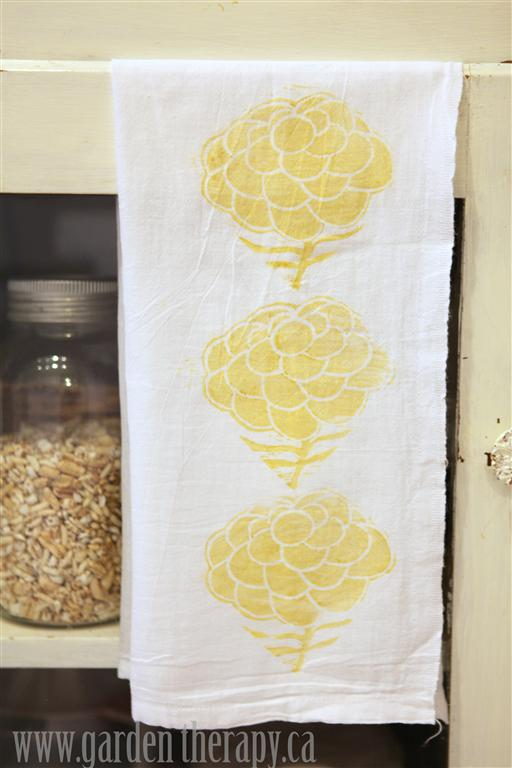 Close Up Of Stamped Yellow Dahlia Linoleum Block Printed Tea Towels