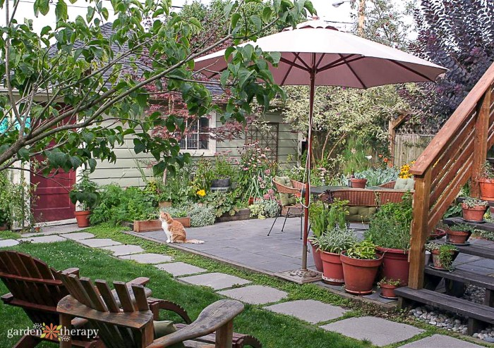 Beautiful garden patio with umbrella and potted plants
