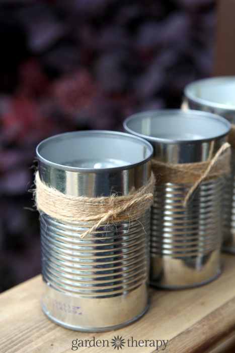 DIY citronella candles in upcycled soup cans