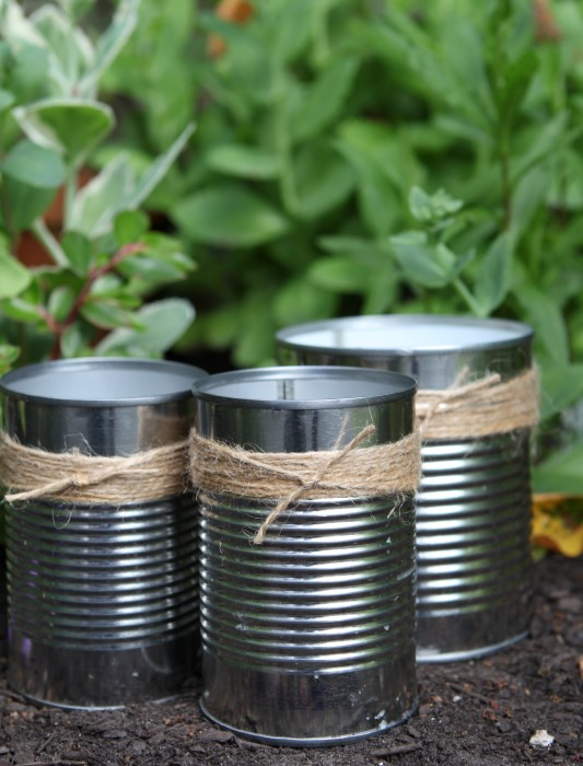 DIY upcycled citronella candles in recycled soup cans