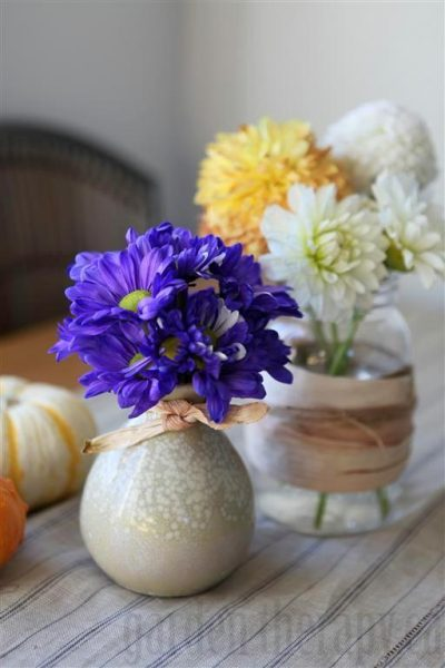 Dyed Blue Mums in arrangement