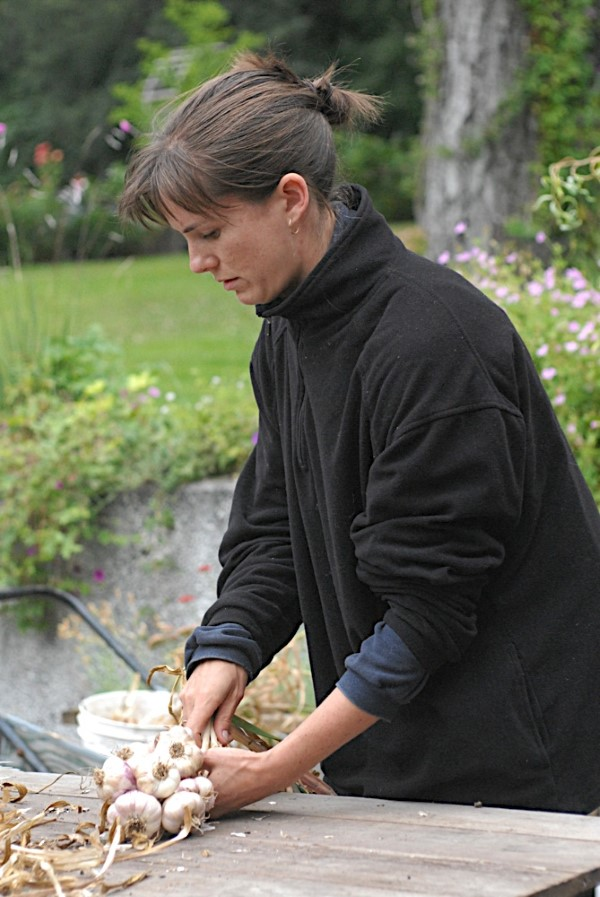 Woman making a garlic braid