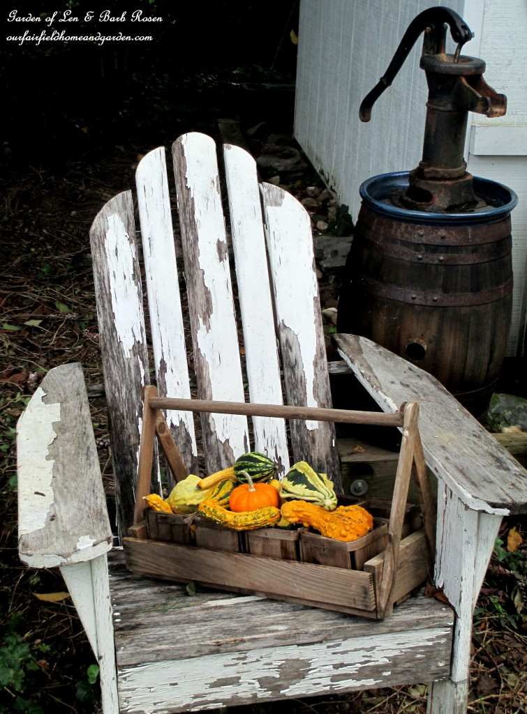 Fall Vignette with Pumpkins and Sqaush on Weathered Chair