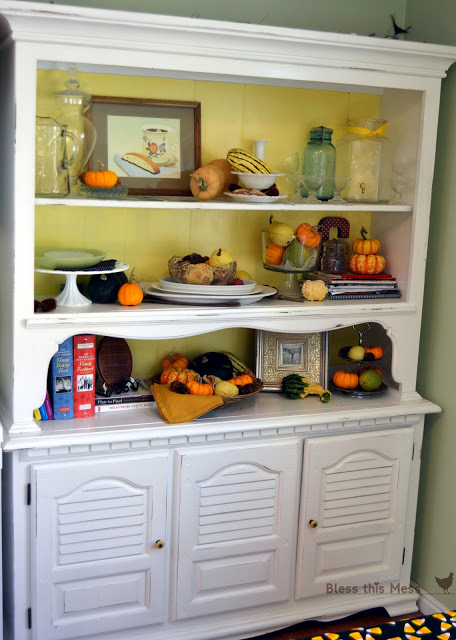house remodeling painted hutch with fall decorations