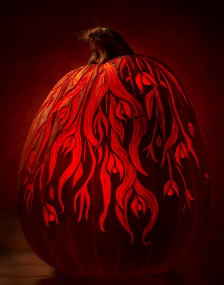etched pumpkin carving design - falling foliage