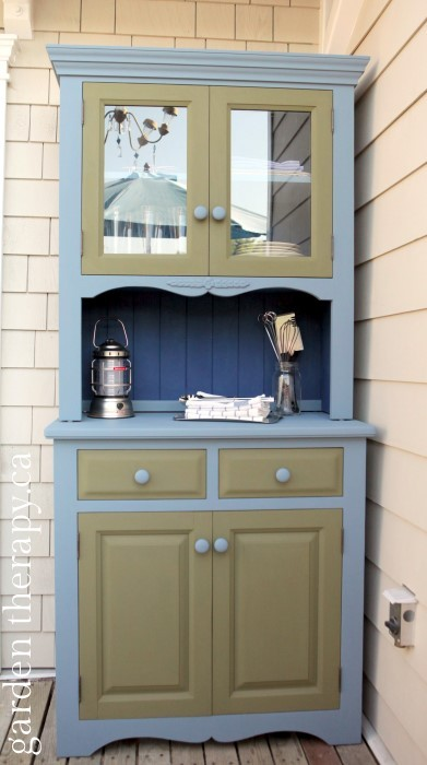 Love this painted outdoor cabinet for deck storage