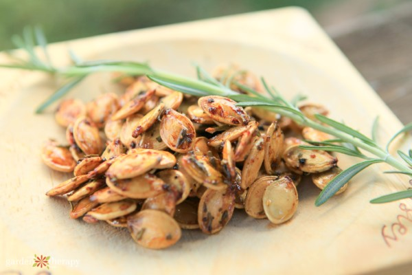 roasted pumpkin seeds with a sprig of rosemary