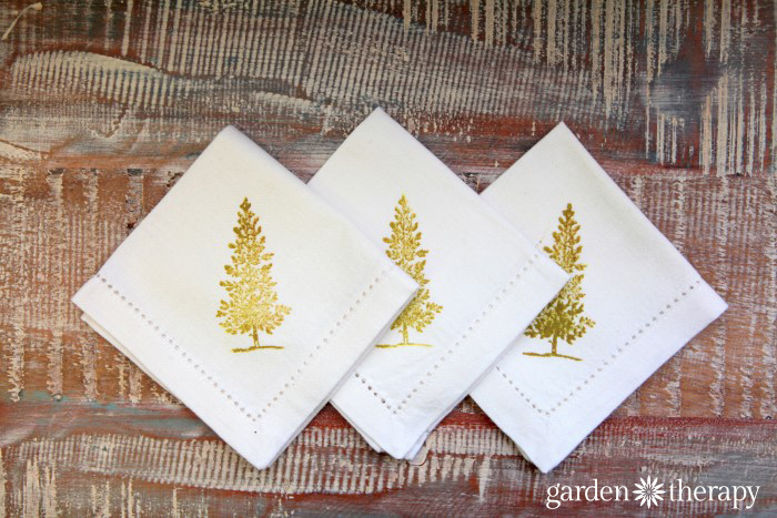 Set of cocktail napkins embellished with hand stamping