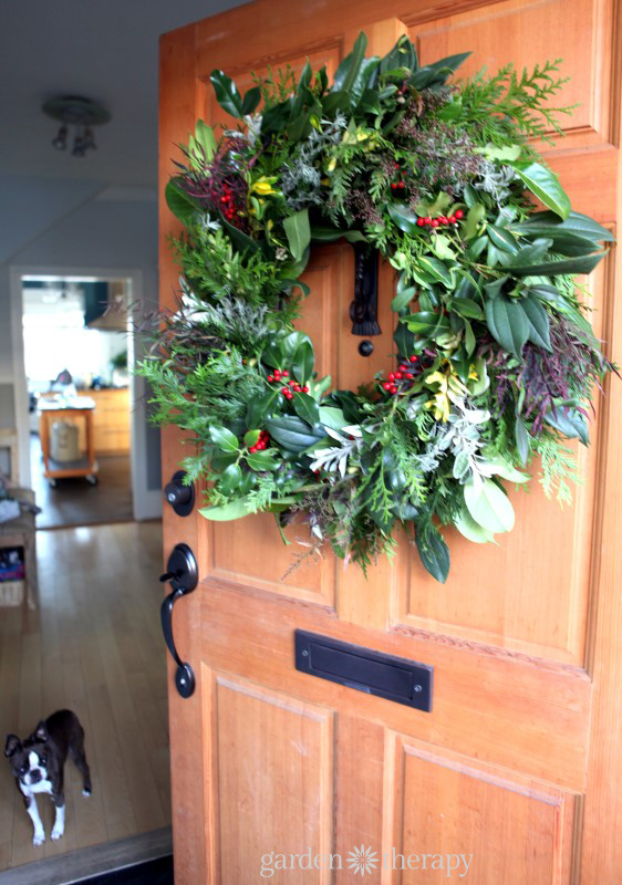 A warm welcome to holiday guests with this stunning evergreen wreath