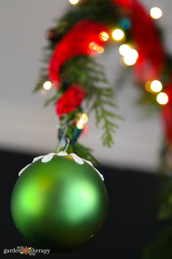 close up of a green ornament on a Christmas tree
