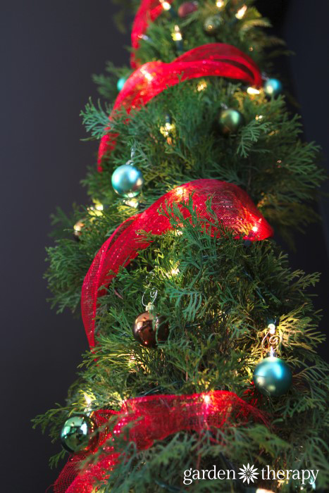 winding decor mesh around the tree from Christmas tree from How to Make a Nine Foot Grinch Tree