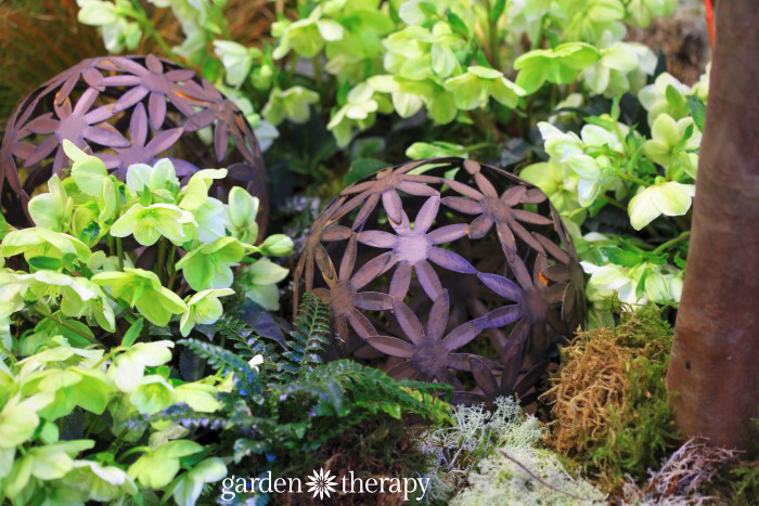 Rusty Floral Garden Balls from the Blue Greenhouse Seaside Garden Design Feature