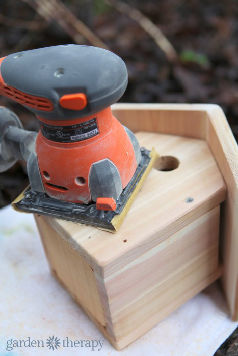 sanding the bird house from how to make a metalwork birdhouse