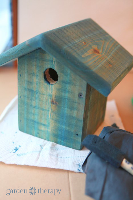 staining the bird house from how to make a junk metalwork birdhouse