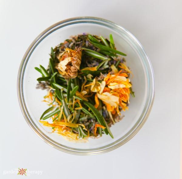herbal blend of rosemary calendula lavender in a bowl