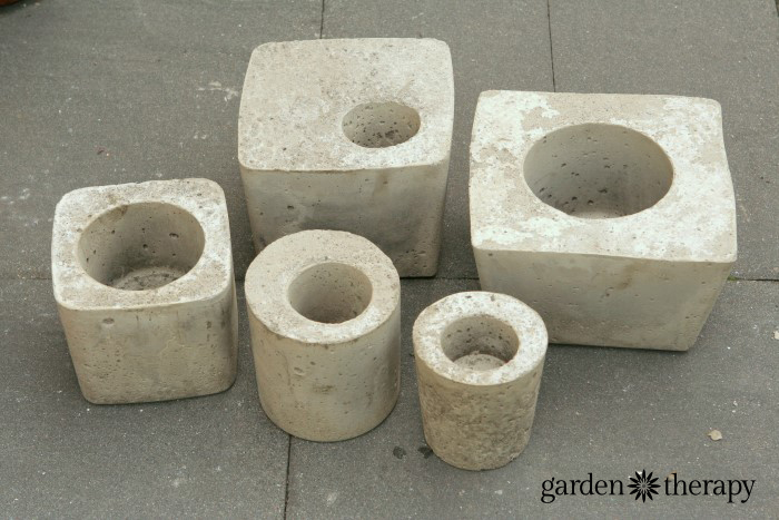 Large and small cement planters made from easy DIY concrete molds & How to Make Concrete Planters