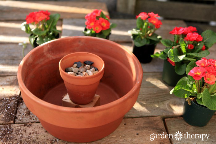 Make a gorgeous outdoor centerpiece with just a few annuals, terracotta pots and a candle!