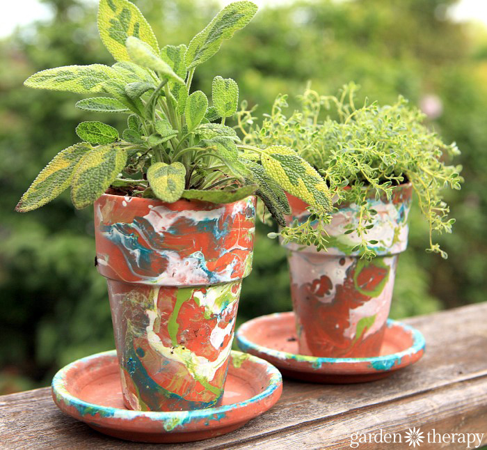 Verigated Sage And Thyme In A DIY Nail Polish Marbled Terracotta Garden Pot