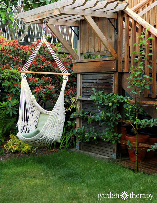 Garden Therapy Back Yard Play Garden Tour Apple espalier and hammock chair