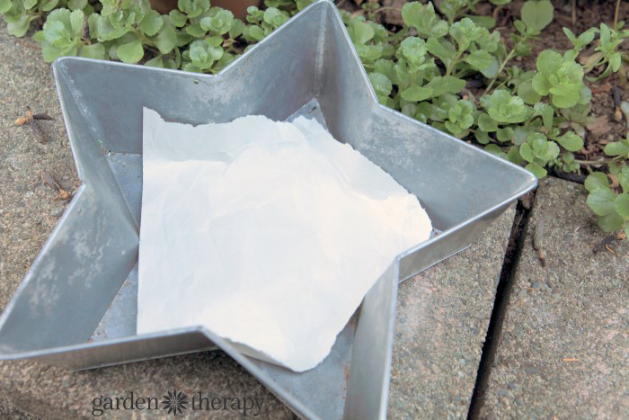 Line the planter with paper