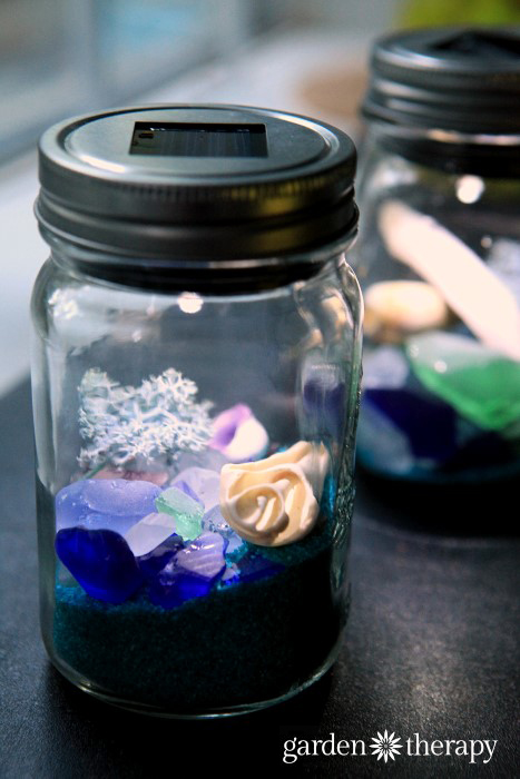 These DIY Beach Mason Jar Solar Lights really cast a glow reflected off the beach glass