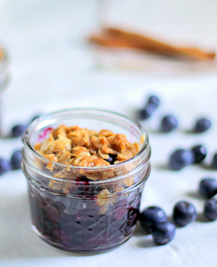 Mini blueberry crisp baked in mason jars