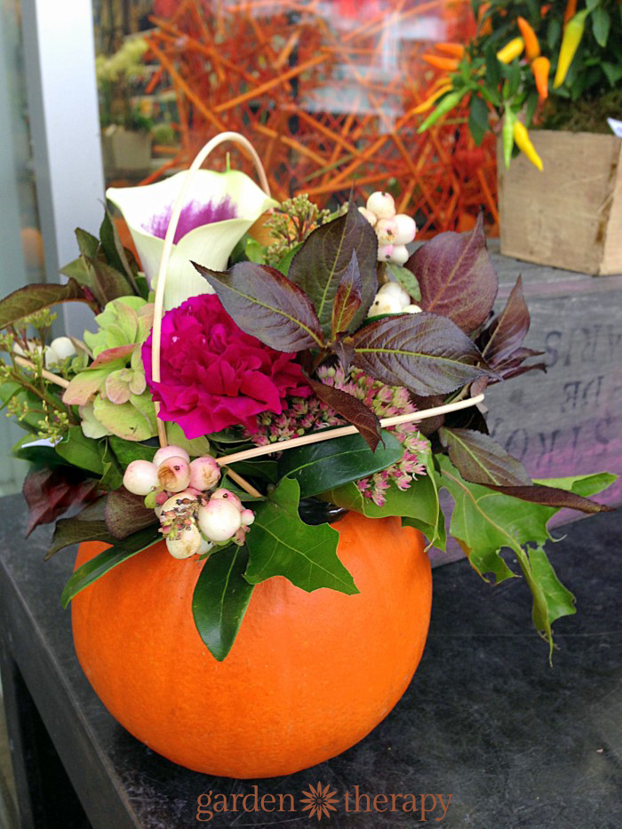 Fall leaves and berries pumpkin arrangement