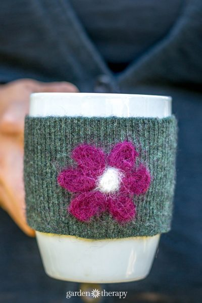Felted recycled wool sweater tea cozy with flower applique