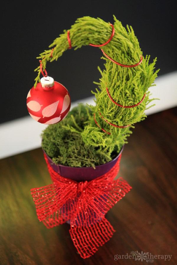 decorating a tiny grinch tree