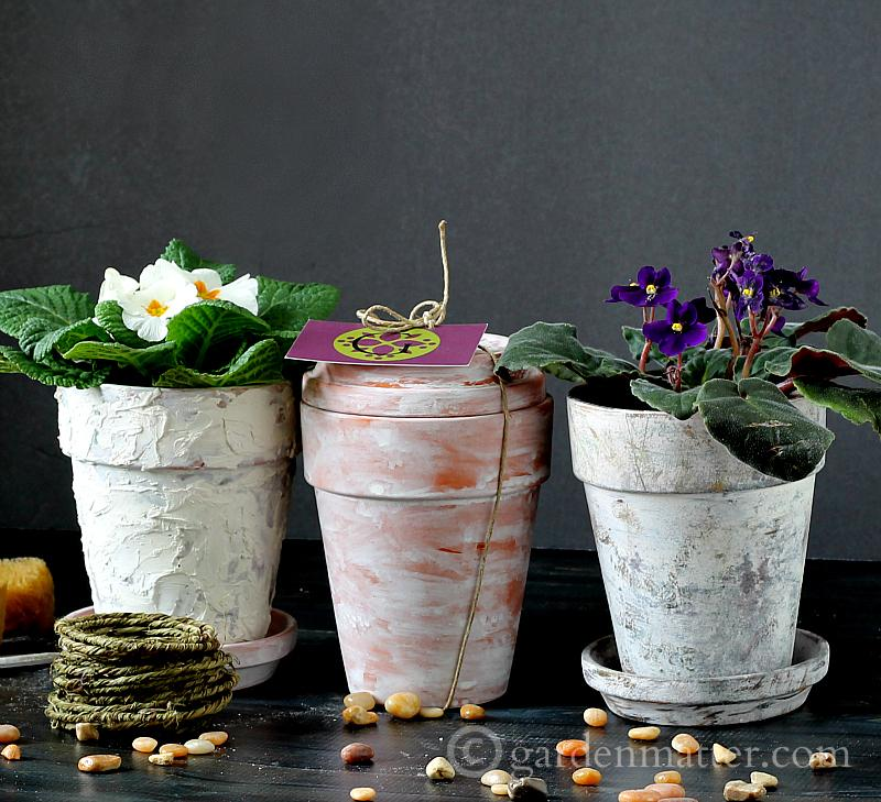 Faux aged pots from 32 terracotta pot hacks