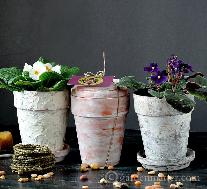 Faux aged pots from 32 terracotta pot hacks