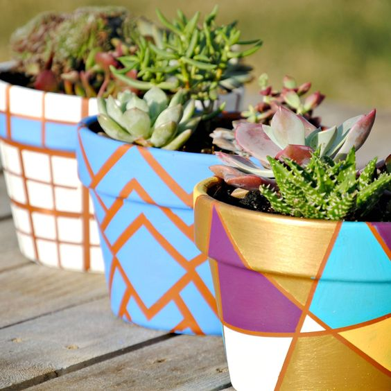 Painted geometric flower pots from 32 Terracotta Pot Hacks