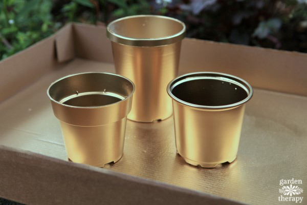 Gold painted plastic pots