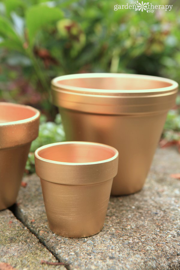 Gold painted terracotta pots AFTER Photo