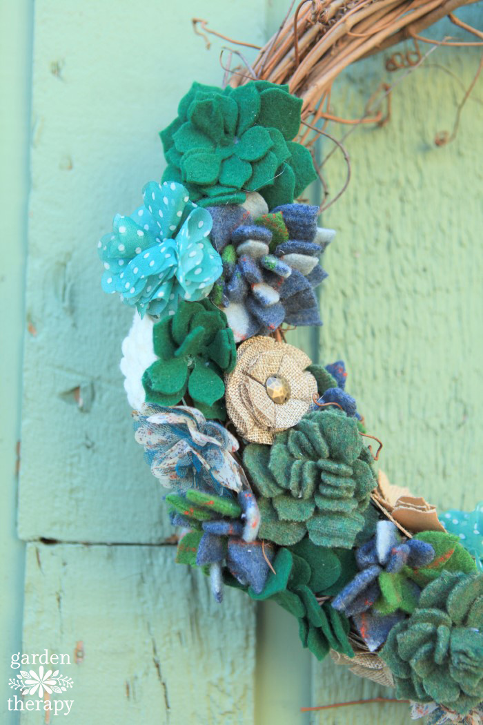Warm up to autumn this year with a cozy fall wreath made from thrifted sweaters. This felted succulent wreath is a unique design that is easy to make.