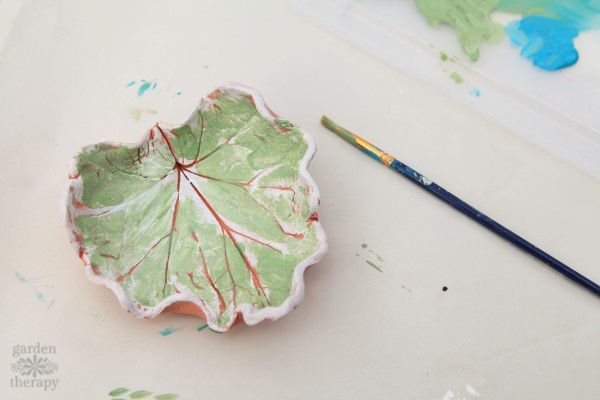 Painting a clay bowl