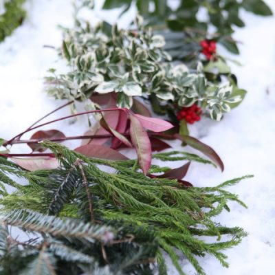 A rustic and natural Christmas candle centerpiece planter can be used as table decor, fireplace mantle, or even outdoors on the porch. See the DIY.