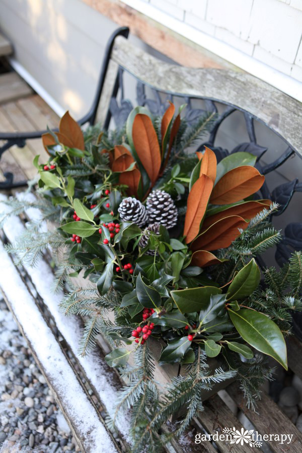 Create a festive holiday window box with a wood planter and some fresh greenery. You will quickly have a long lasting planter to freshen up the outdoors.