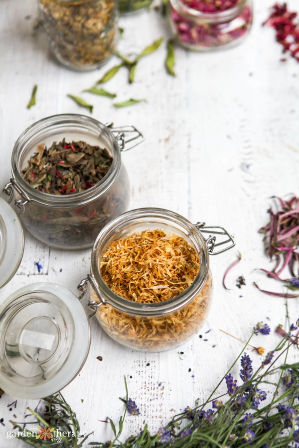 dried herbs and flowers for tea in glass jars