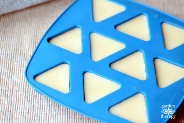 Blue ice tray triangular mold with white vanilla lotion hardening