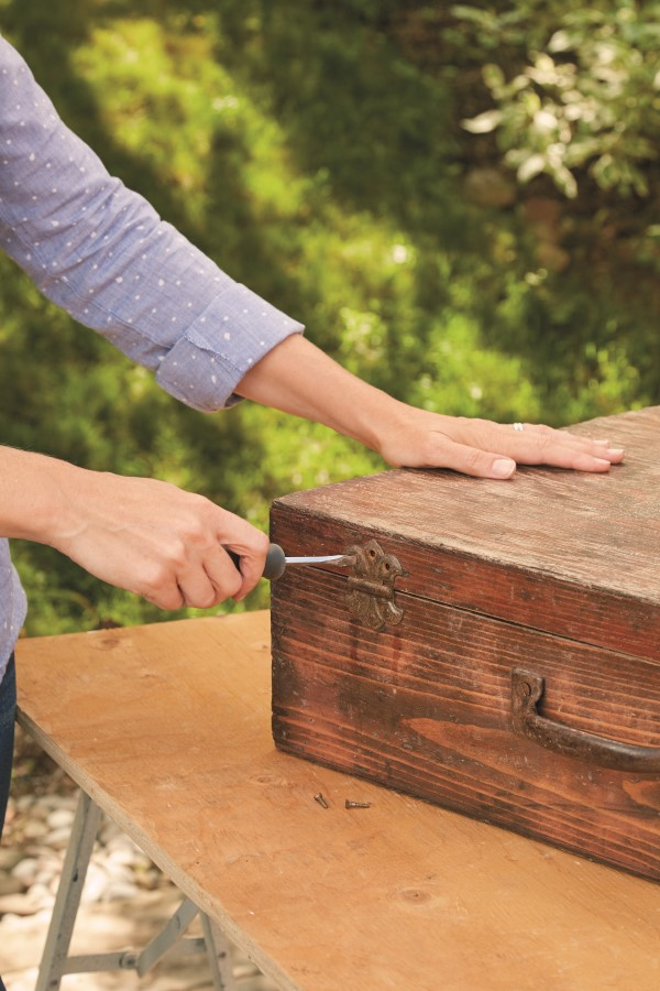 Prep a vintage suitcase to upcycle into a planter
