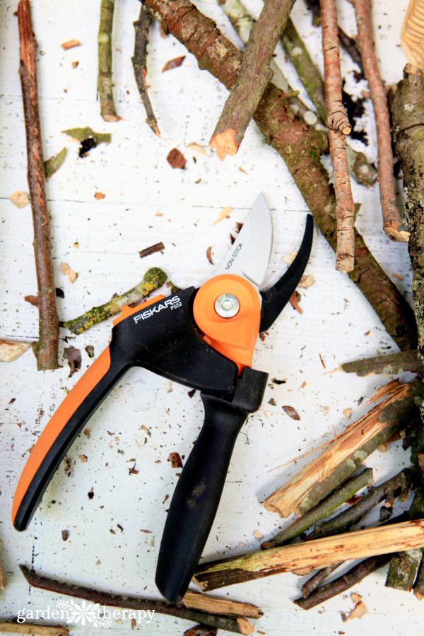 Fiskars pruners for bug hotel fence art