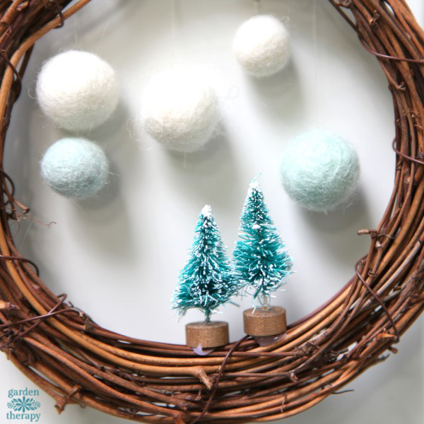 Make a whimsical winterscape on a wreath in a few simple steps.