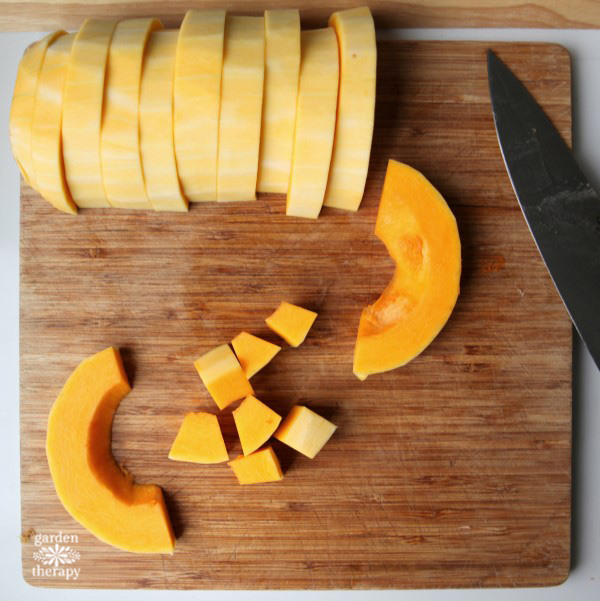 Slicing butternut squash to size before roasting it.