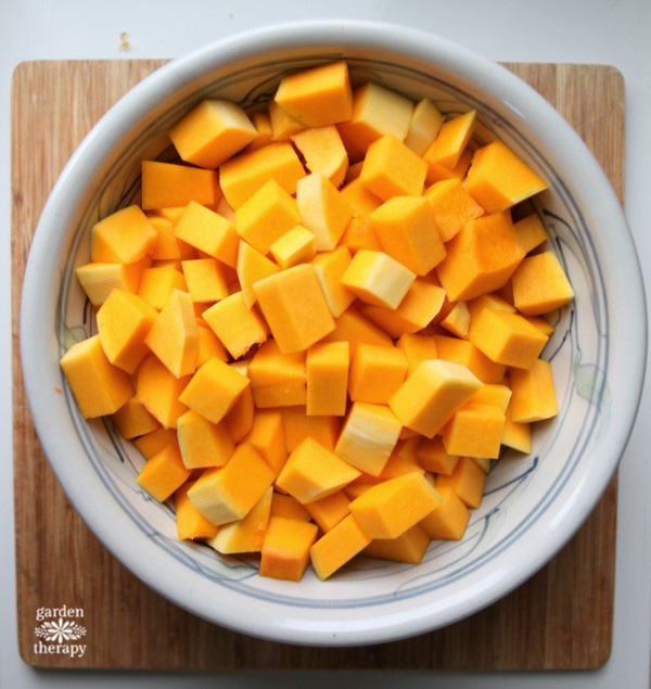 Cut butternut squash into small cubes to roast it