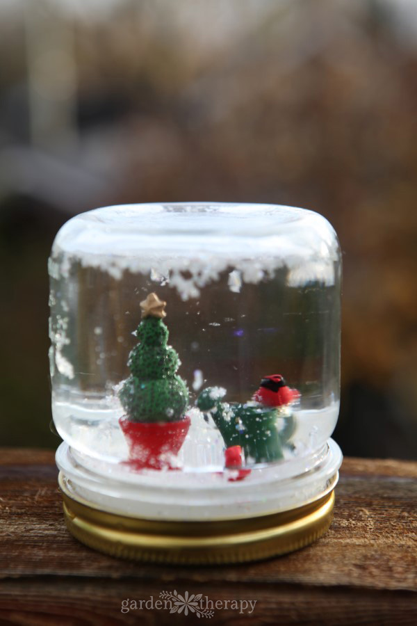 Make a mini garden snow globe.