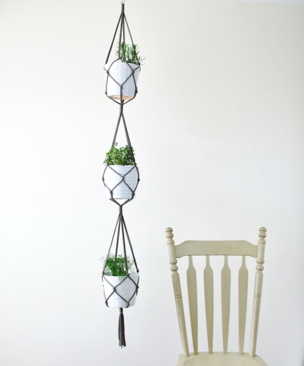 This macrame vertical plant hanger looks great and saves space