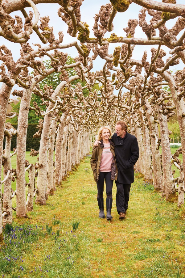 Sting and Trudie in their tree-lined walkway
